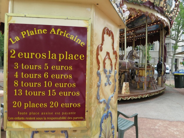 Quaint carousel turning about just outside the main park area